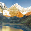 Peru Mountain Sunrise Panorama. The Huayhuash mountain range reflecting in lake Carhuacocha at sunrise, Peru Stock Photo