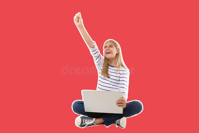 excited teen girl sitting on the floor, celebrating success with arm raised,isolated royalty free stock photo