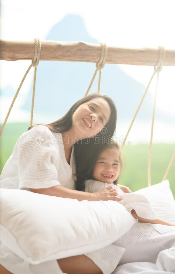 girl and her mother enjoy sunny morning. Good time at the nature background of the valley royalty free stock photography