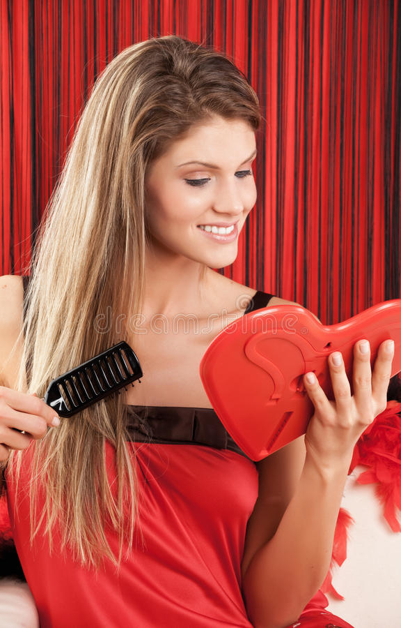 smiling beautiful young woman combs hair royalty free stock photo