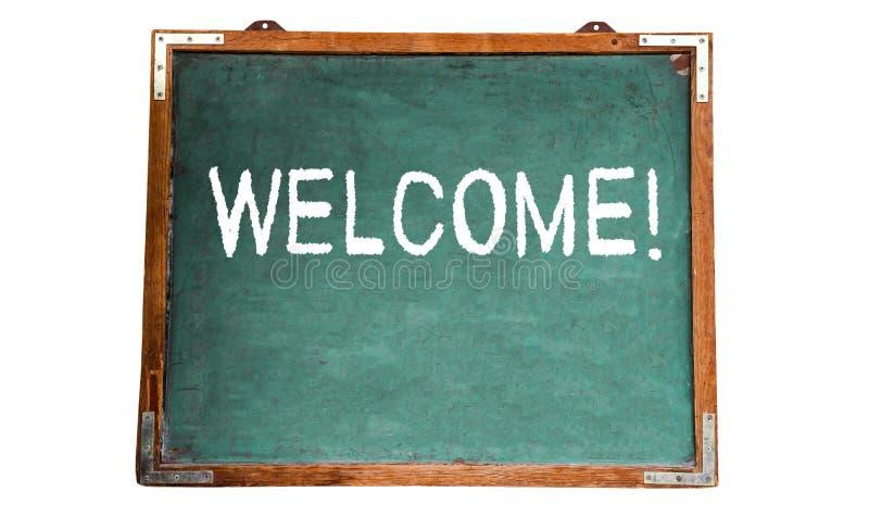 ¡ Bienvenido! mensaje de texto en la tiza blanca escrita en una pizarra de madera o una pizarra del viejo vintage sucio del verde imágenes de archivo libres de regalías
