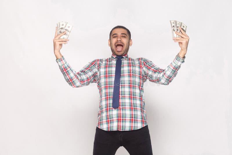 ¡Vaya loco con éxito! Hombre barbudo hermoso rico en chec colorido fotos de archivo libres de regalías