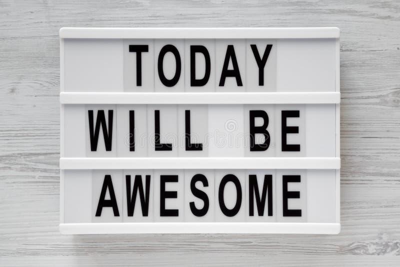 «Dzisiaj będzie wspaniałymi «słowami na lightbox nad białą drewnianą powierzchnią, odgórny widok obraz stock