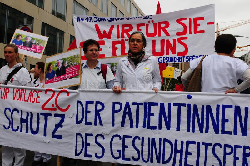 «More labour protection, higher salary, more pension» is the demand of the demonstrators in Zürich royalty free stock image