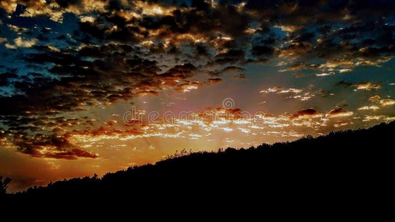 º del› del â del † del 🌠di tramonto immagine stock