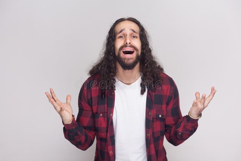 ¿Qué debo hacer? hombre infeliz triste con la barba y el cur largo negro fotografía de archivo libre de regalías