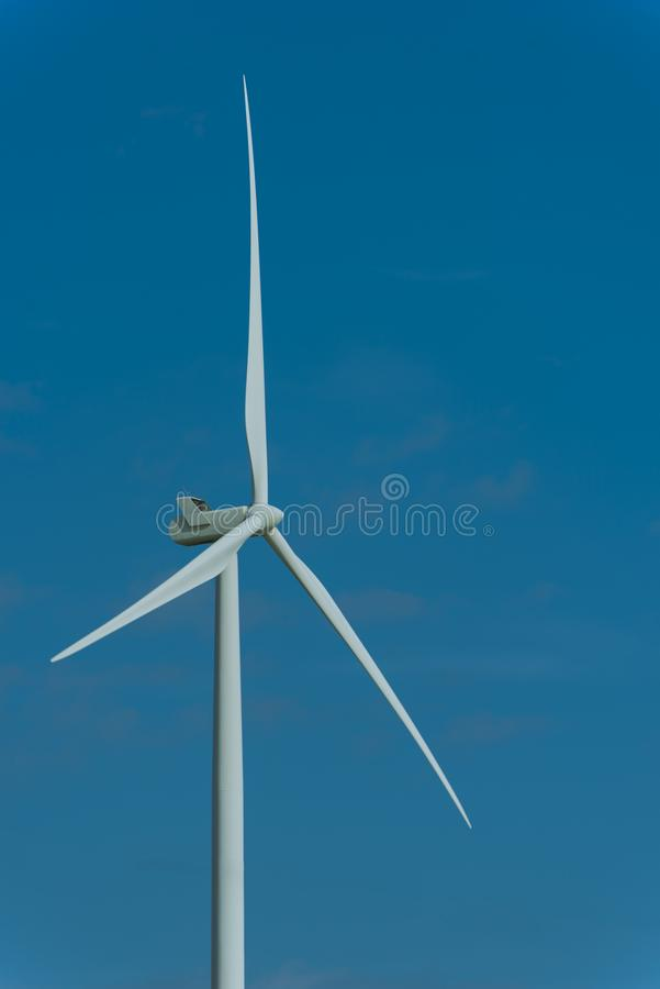 Wind turbines and the morning sky with sunlight stock image
