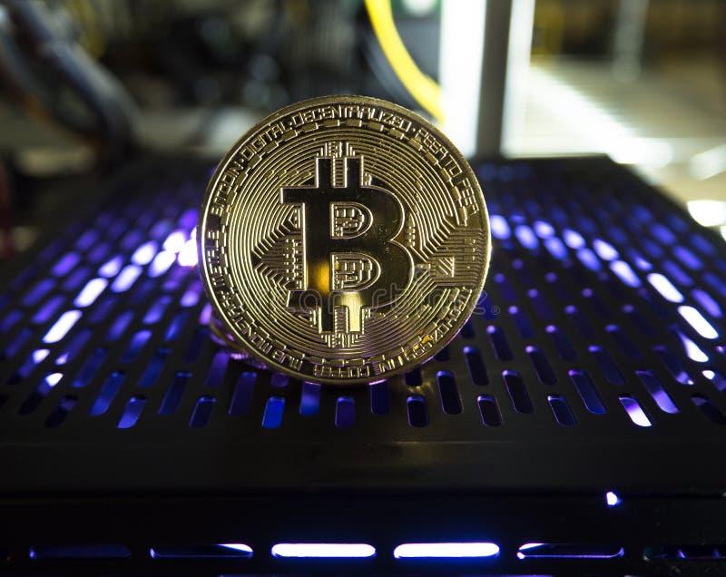 à¸'Bitcoin muntstuk op powersuppuly royalty-vrije stock foto's