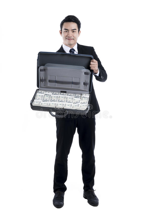 โถThe Young executive man holding a baggage with banknote stock photo