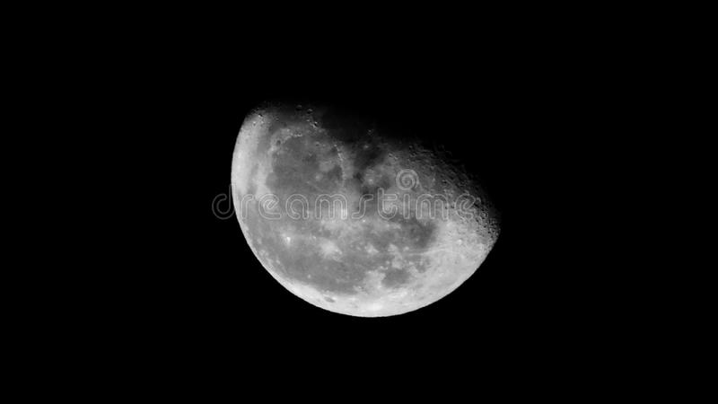 À lua e à parte traseira foto de stock