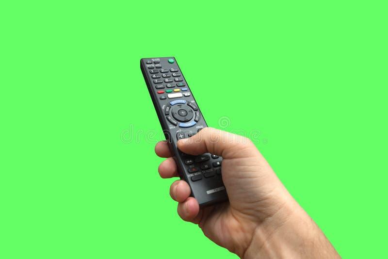 À télécommande à disposition sur l'écran vert images stock