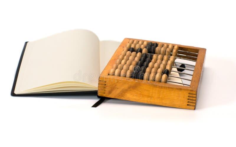 Ábaco y cuaderno. foto de archivo libre de regalías
