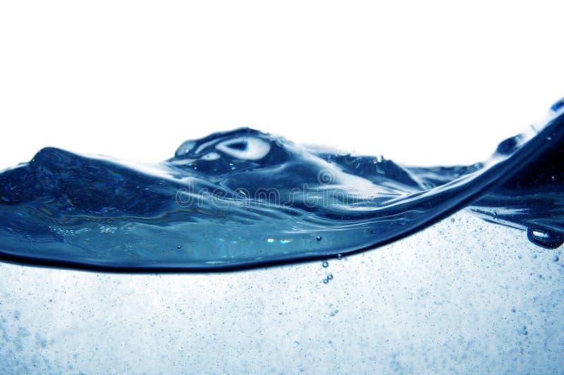 Água azul com bolhas foto de stock