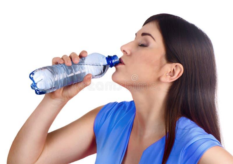 Água bebendo de mulher nova fotografia de stock royalty free
