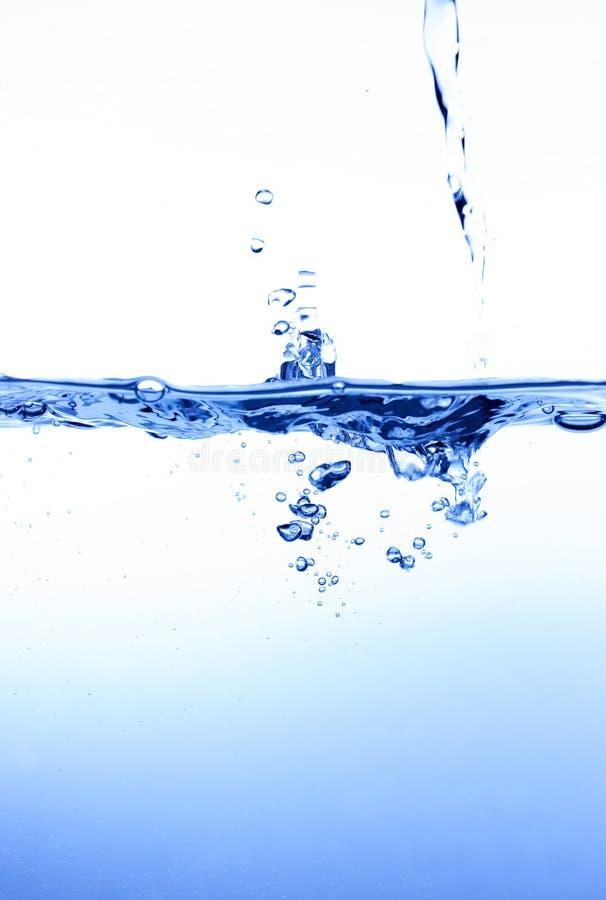 Água de derramamento imagem de stock royalty free