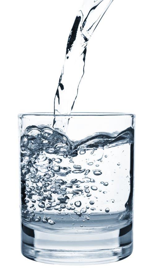 Água de derramamento no vidro foto de stock royalty free