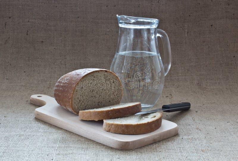 Água e pão fotos de stock