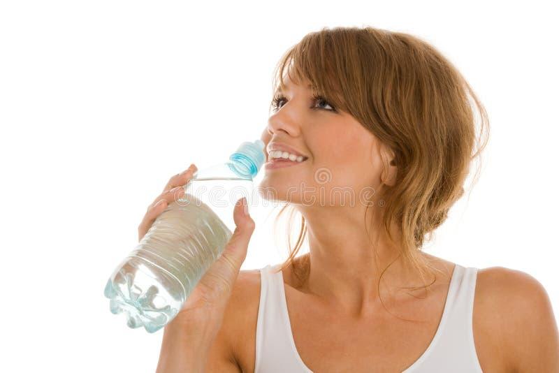 Água potável da mulher imagem de stock royalty free