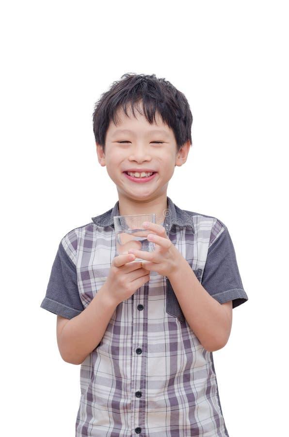 Água potável do menino sobre o fundo branco imagem de stock royalty free