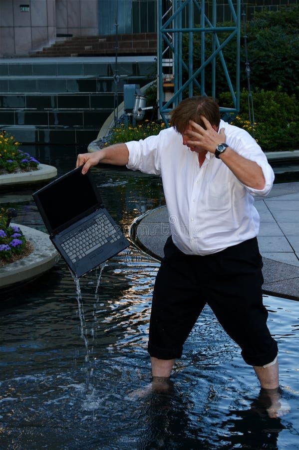 A água registrou o portátil fotografia de stock