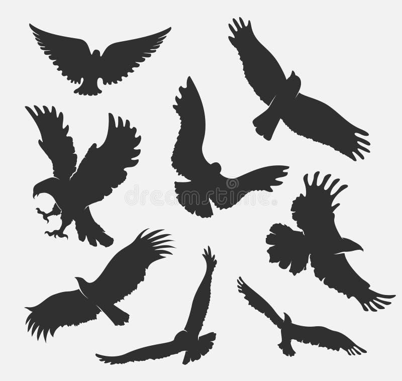 Águia do voo da silhueta no fundo branco ilustração royalty free