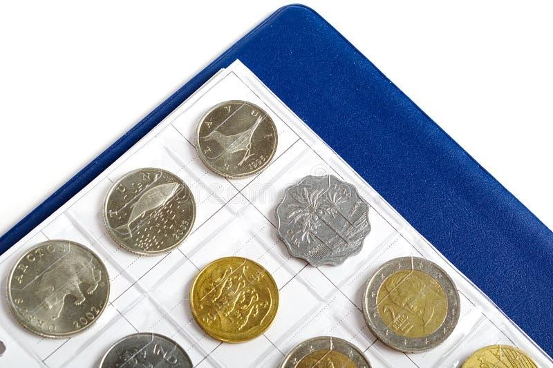 Álbum con las monedas para el numismatics fotos de archivo libres de regalías