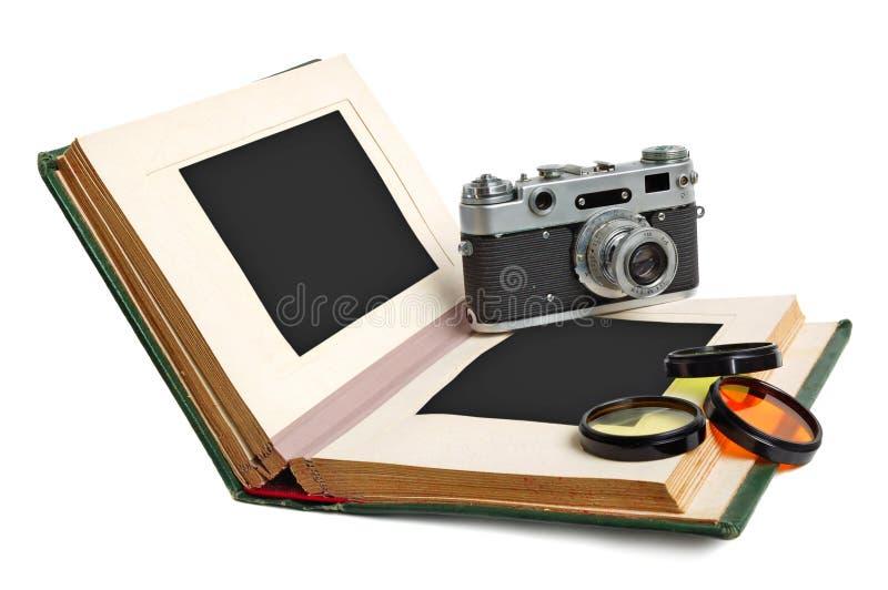 Álbum de fotografias e câmera foto de stock