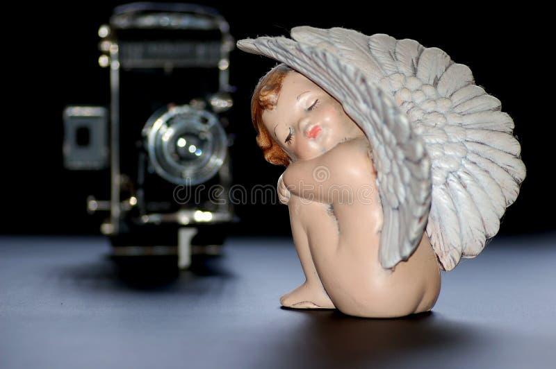 Ángel con la cámara imagenes de archivo