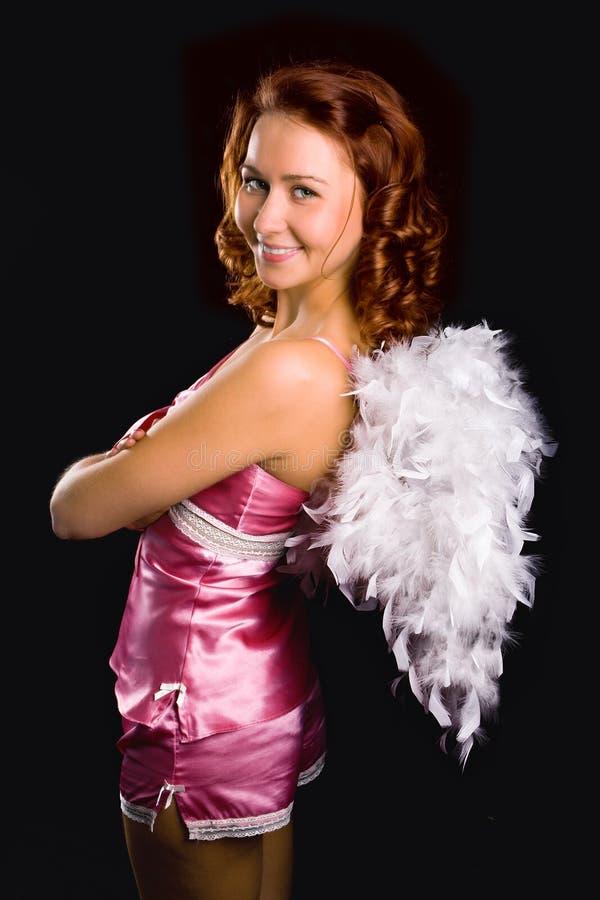 Ángel de la muchacha de la belleza en color de rosa foto de archivo libre de regalías