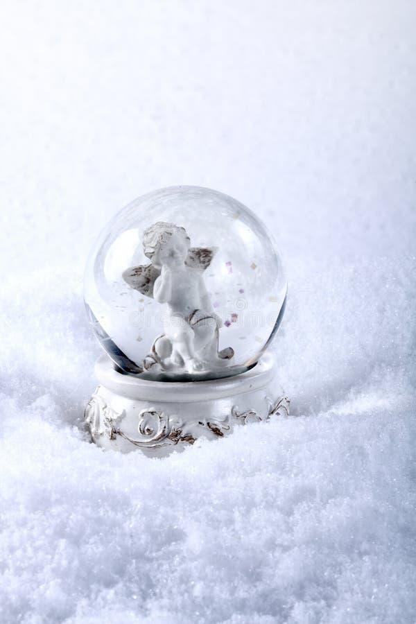 Ángel en la esfera de cristal fotografía de archivo libre de regalías