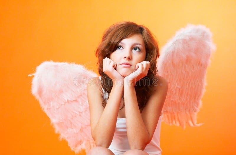 Ángel profundamente en pensamiento. fotos de archivo