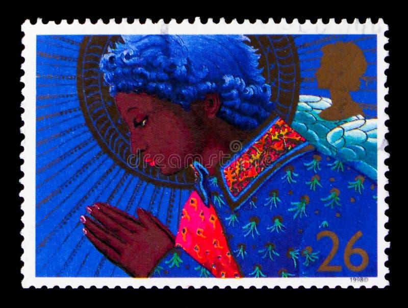 Ángel que ruega, la Navidad 1998 - serie de los ángeles, circa 1998 imágenes de archivo libres de regalías