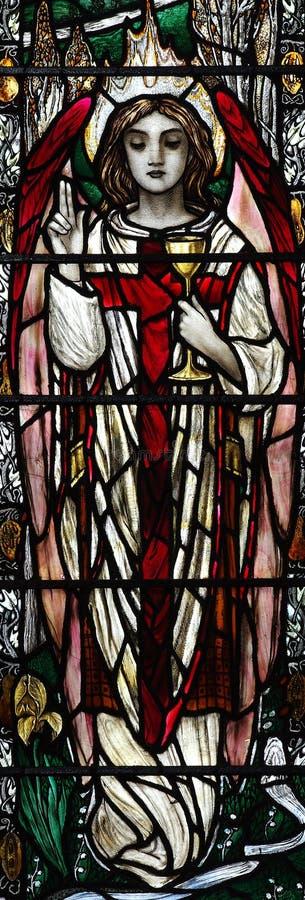 Ángel que sostiene una taza (vitral) stock de ilustración