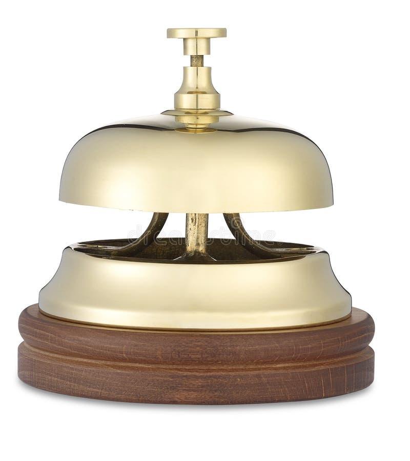 Ángulo inferior de la alarma de cobre amarillo del hotel en blanco con (camino) imágenes de archivo libres de regalías