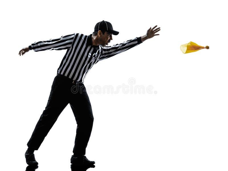 Árbitro do futebol americano que joga a silhueta da bandeira amarela imagem de stock royalty free