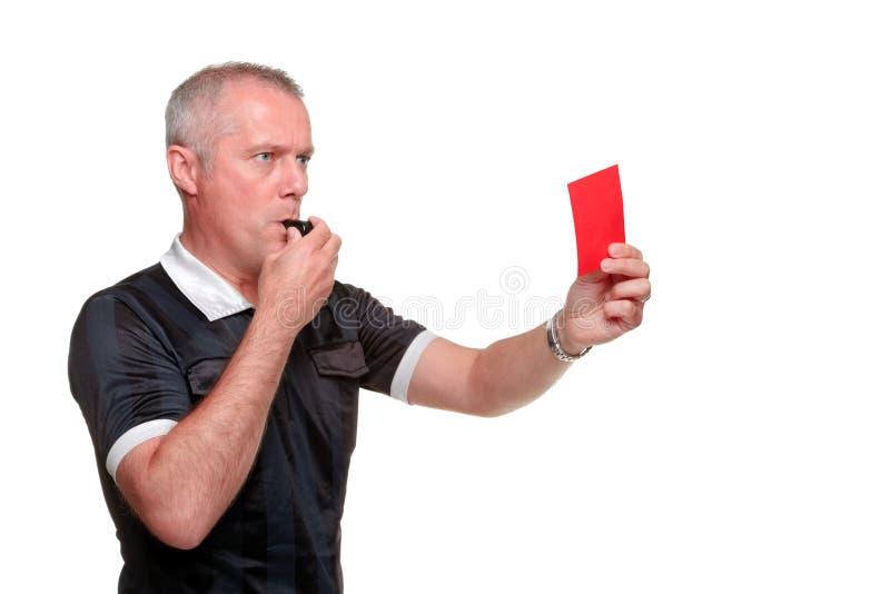 Árbitro que mostra o perfil do lado do cartão vermelho fotos de stock