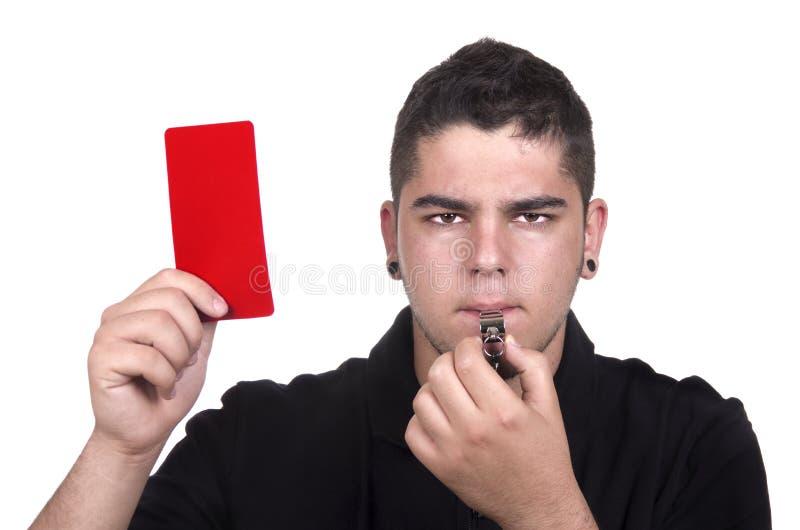 Árbitro que sostiene la tarjeta roja para el concepto asqueroso imagen de archivo libre de regalías