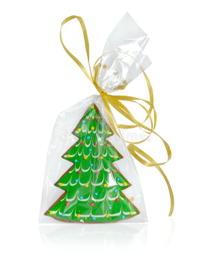Árbol de navidad - pan de jengibre en el embalaje transparente con un arco imagen de archivo libre de regalías