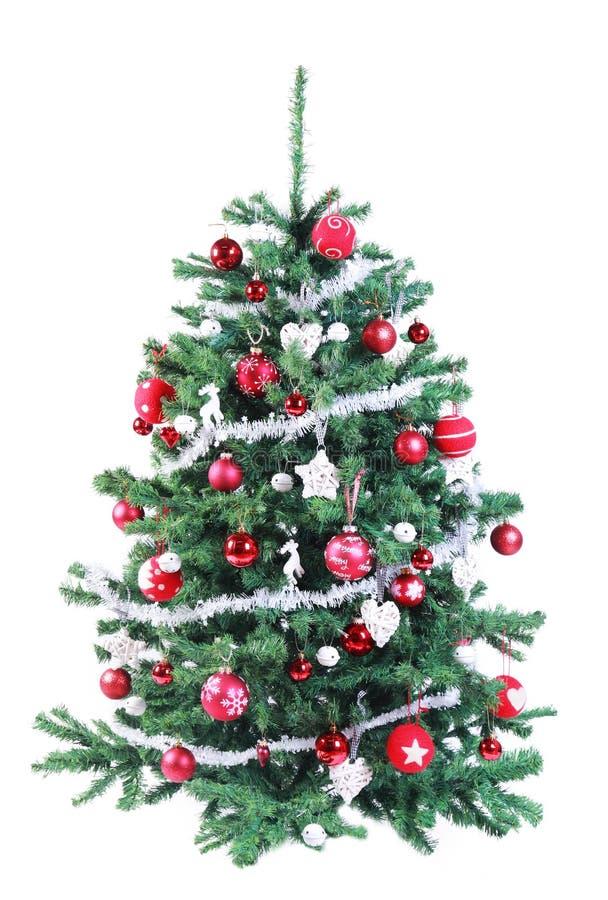 Árbol de navidad rojo y de plata adornado colorido fotos de archivo libres de regalías