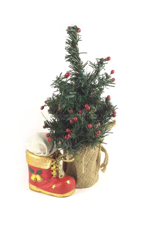 Árbol del Año Nuevo y bootee de la Navidad fotos de archivo libres de regalías