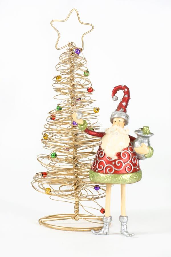 Árbol y duende de oro de Santa fotos de archivo libres de regalías