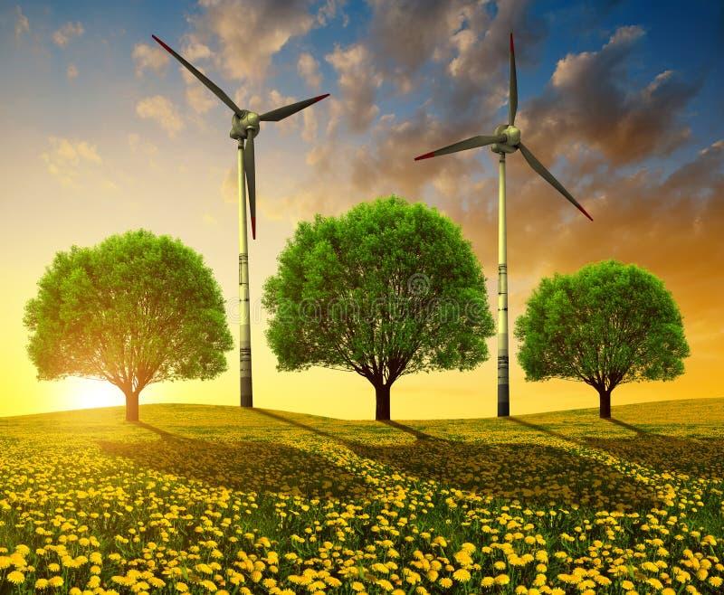 Árboles con las turbinas de viento en prado en la puesta del sol imagen de archivo libre de regalías