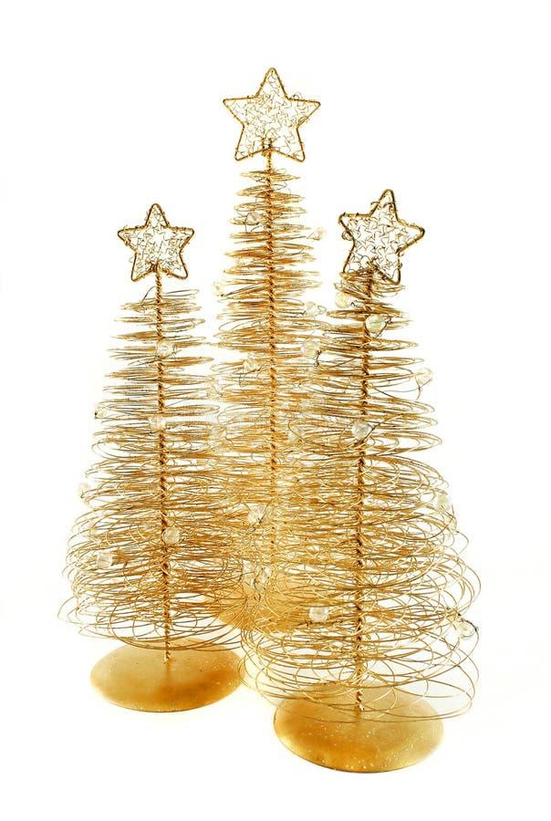 Árboles de navidad de cobre amarillo imágenes de archivo libres de regalías