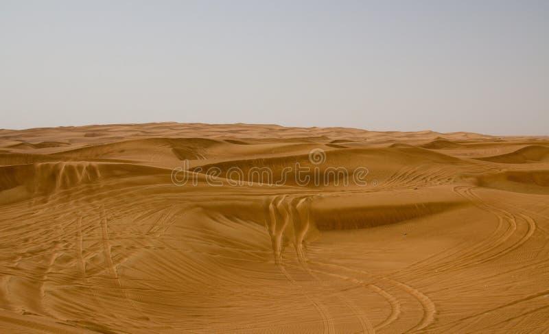Área do deserto em Dubai, UAE Os turistas são tomados frequentemente a este lugar para safaris do deserto e bashing da duna foto de stock royalty free