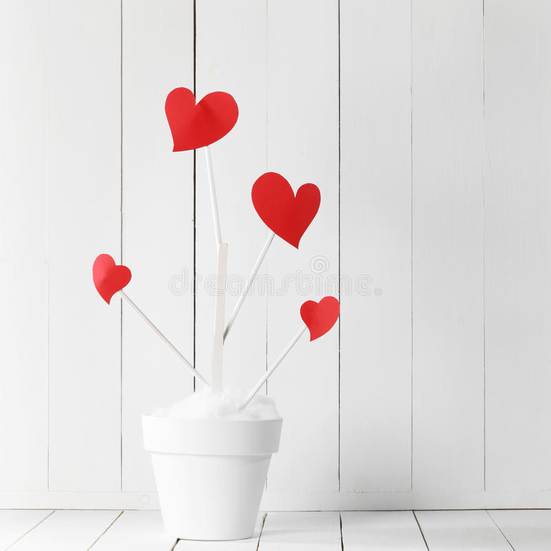 Árvore de amor no potenciômetro de flor fotos de stock