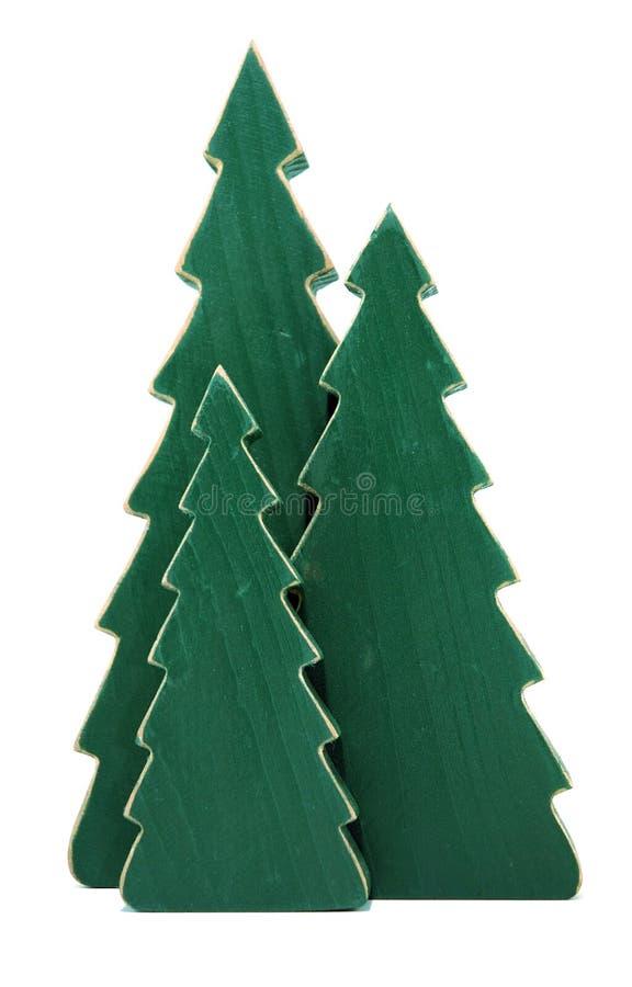 Árvores de pinho de madeira de encontro ao branco fotos de stock royalty free