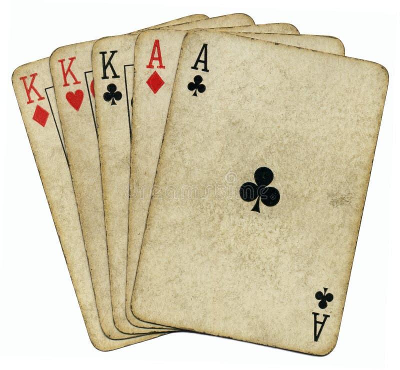 Ás da casa cheia e cartões velhos dos reis. imagem de stock