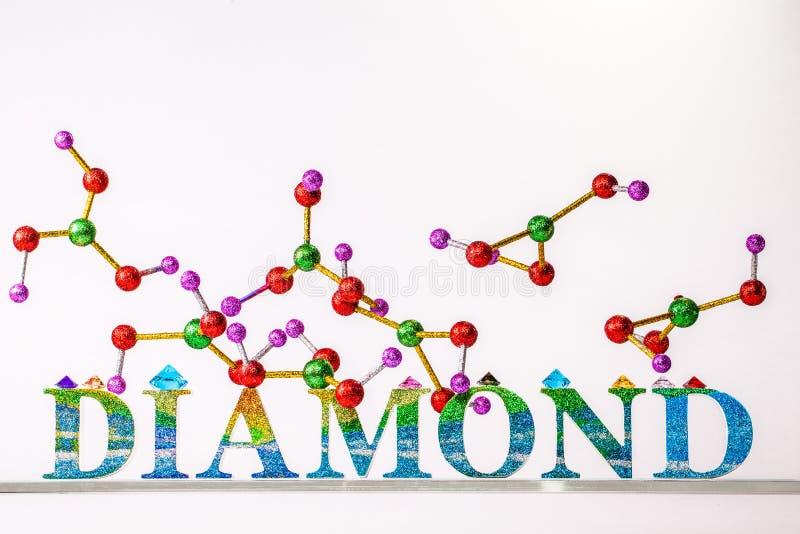 Átomo da letra acima do diamante do brilho do diamante fotografia de stock