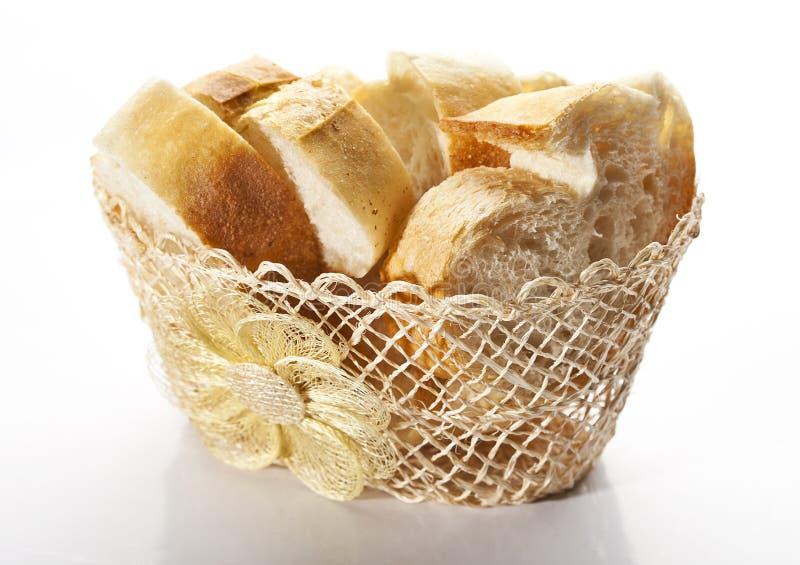âEUR. Freshly baked bread in a wicker basket royalty free stock photos