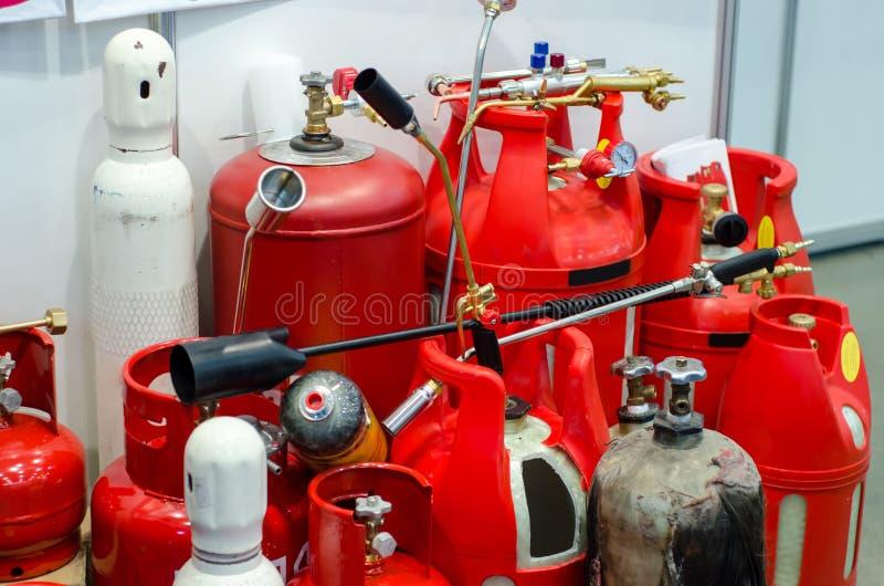 不同的丙烷储罐,集气筒 图库摄影